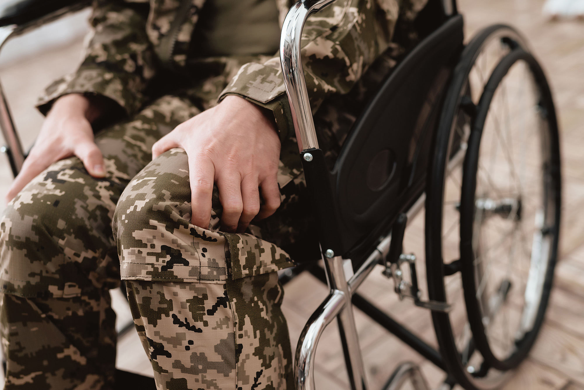 Army, Navy, Air Force Injury and Accident Compensation - Veteran in wheelchair