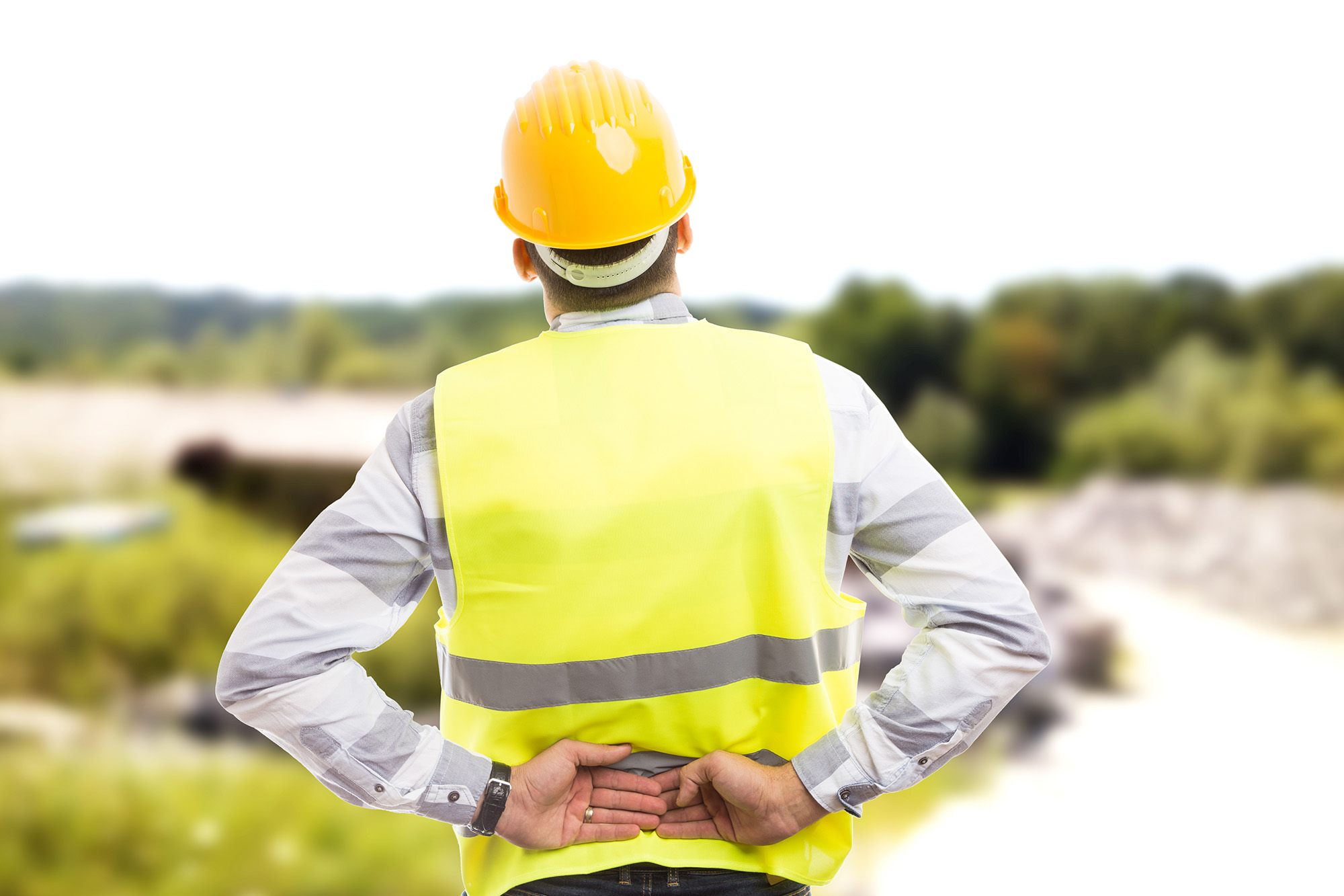 Injured construction worker or engineer suffering backpain in lower back area outdoor at work